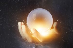 hand with crystal ball-understanding law of attraction