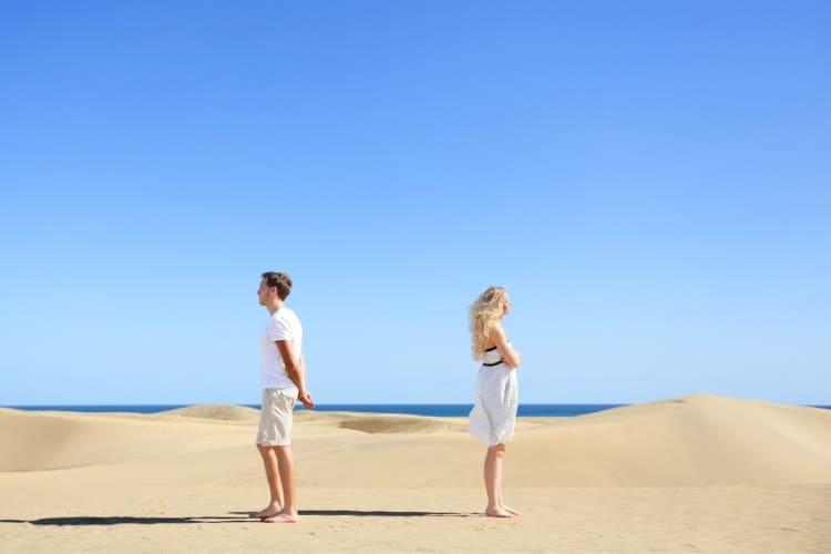 man and woman on beach arguing-move on and let go