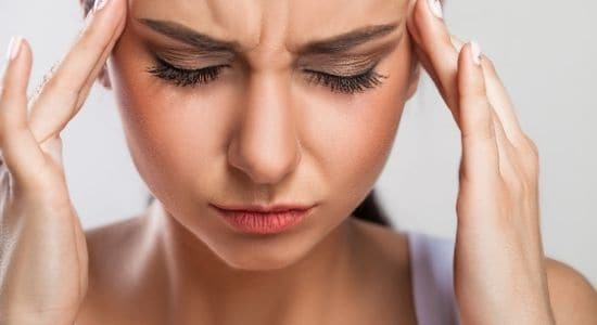 woman with a headache-how to let go of anger and stress