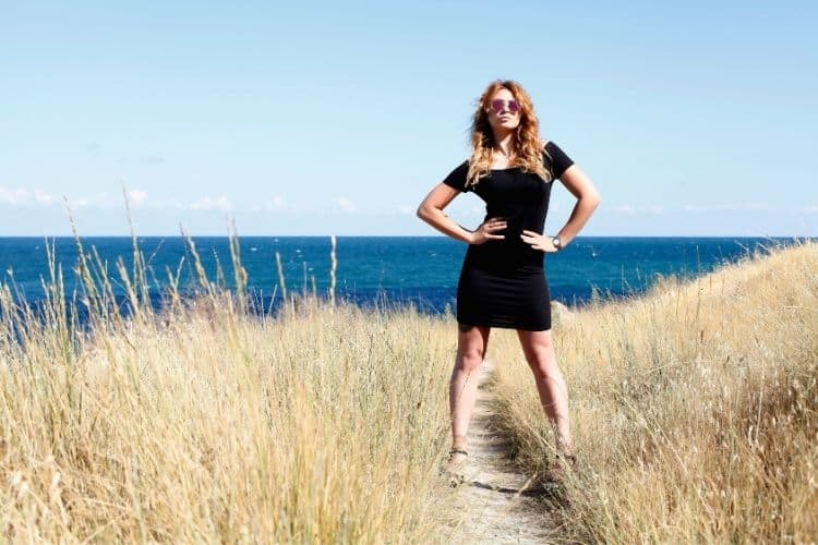 woman standing in grass-strong personality traits blog
