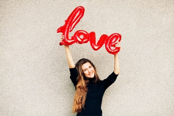 woman holding the word love-unique valentine's day ideas