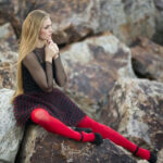 woman sitting on rock-how to find self love