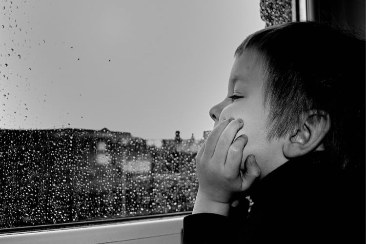 boy looking out the window-stuck at home