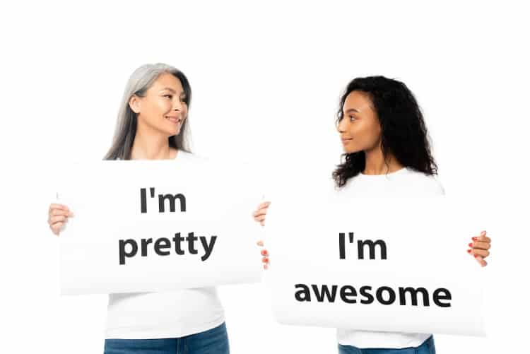 two women standing with i am affirmations
