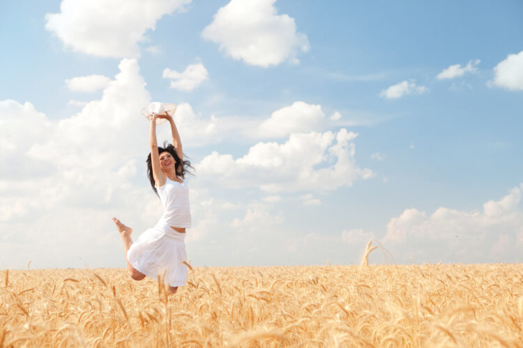 happy woman in fields-jay shetty quotes