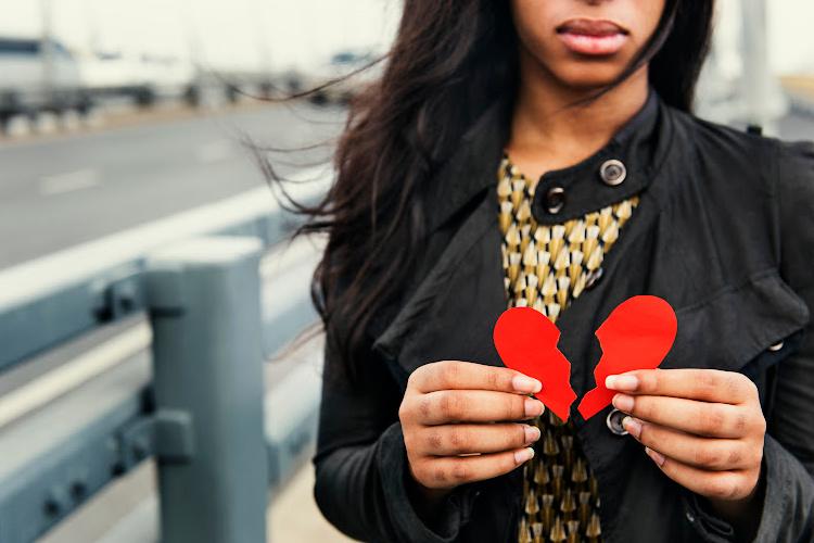 woman holding a broken heart