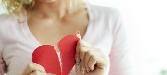 woman holding broken heart-going through a breakup blog post