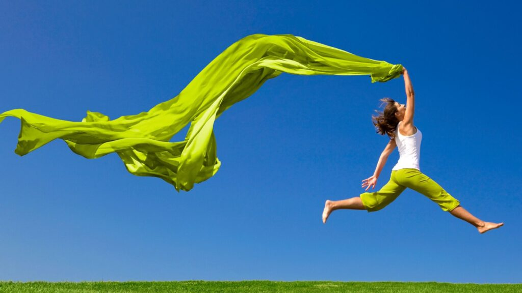 how to live a healthy lifestyle-happy lady jumping