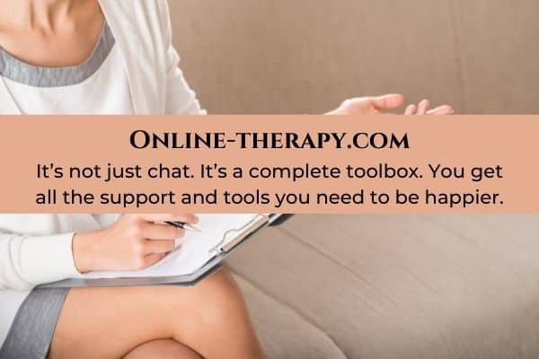 woman sitting talking to a therapist-going through a breakup blog post