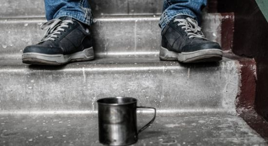 empty mug on stairs-how to help the homeless
