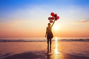 woman on beach with balloons-motivational quotes blog