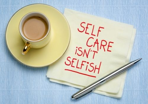 coffee cup and self care text